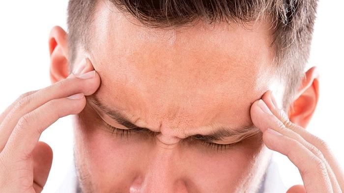 апочему вознкиают боли в височной части головы